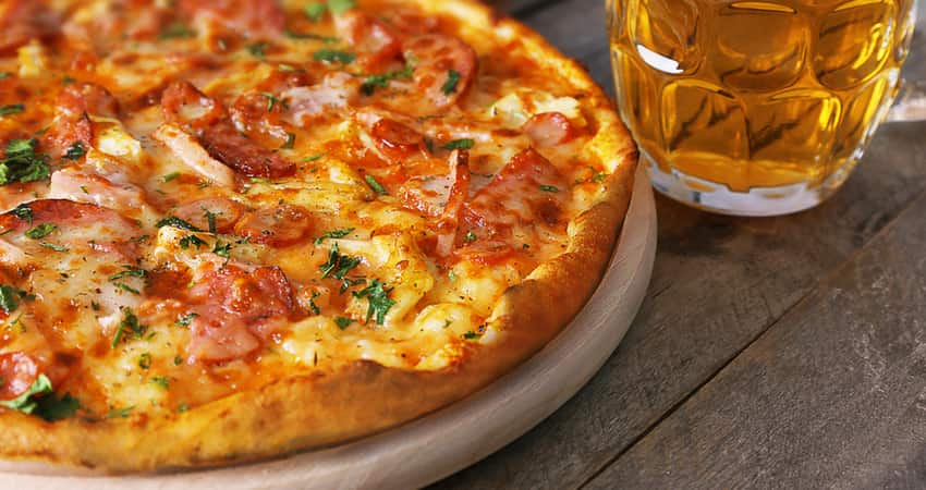 Close up of a pizza and beer
