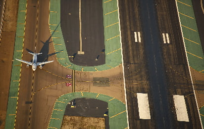 Overhead view of a plane on a runway at San Diego International Airport