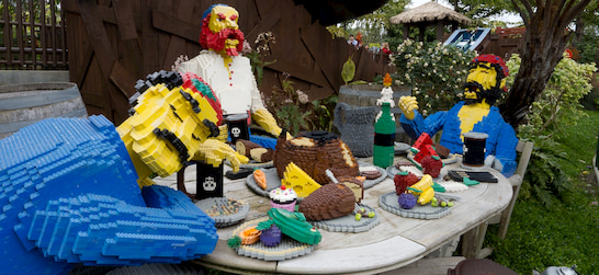 Lego sculptures in the shape of pirates eating a feast at LegoLand California