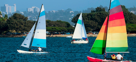 colorful sailboats in Mission Bay in San Diego